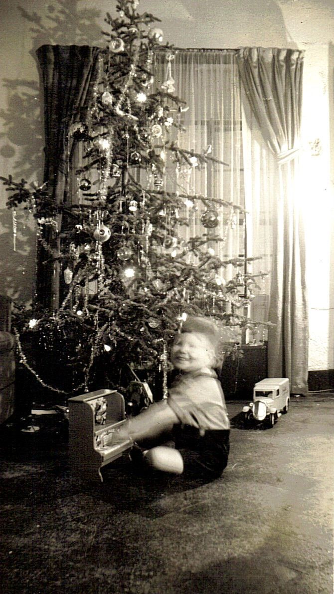 Vintage christmas trees and putzes 1910 - Toddler Boy Plays His Schoenhut Toy Piano Under Christmas Tree