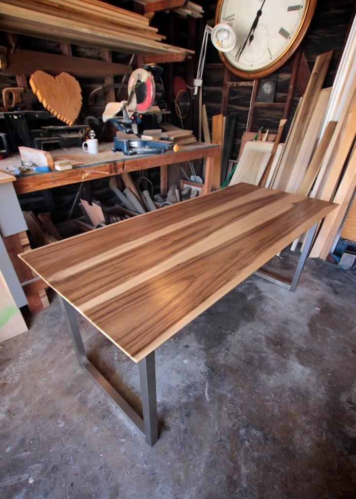 Modern Industrial Minimalist Dining Table // Office Desk // Sun Tanned Wood and Steel. 800.00, via Etsy.