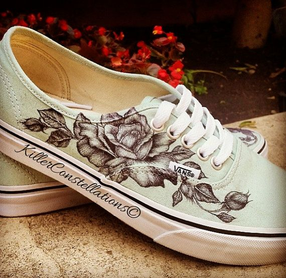 These custom vans are so sick! Maybe white with purple flowers, so many possibilities!