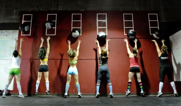 Crossfit . and then do reverse wall balls...Your back is to the wall- squat with med ball, and throw it up on wall over each shoulder, catch, squat, and throw again.