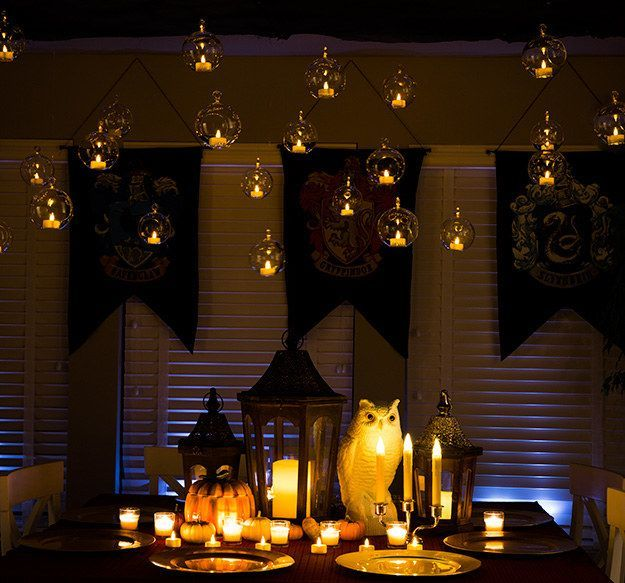 Create a DIY Great Hall by hanging electric tea lights in transparent globes.