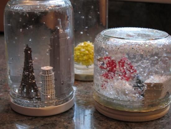 Snow Globes DIY ❄️ Now, I will be honest - snow globes rank rather low on the No Mess scale (there is glitter AND water involved, after all.) And ours did not turn out quite as lovely as those for sale at the mall or made by Martha Stewart. But the kids and I had a grand time designing them. I think we've got a new tradition on our hands.