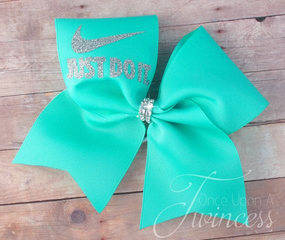 Nike Just Do It cheer bow is made with a single layer of 3 grosgrain ribbon and a glitter nike design This bow contains no metal pieces. This