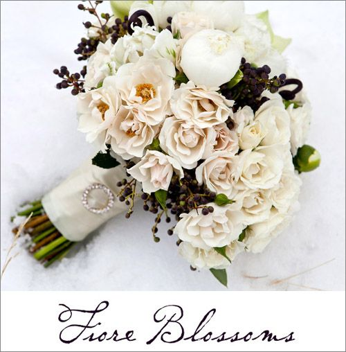 Pure white peonies, ruffled garden roses, and dark viburnum berries were full of wintery romance. This bouquet, created for a winter bride, was so gorgeous in the snow!