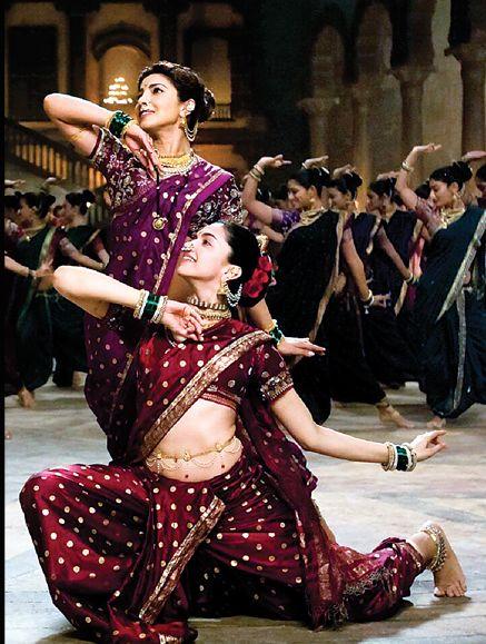 Priyanka Chopra and Deepika Padukonesizzle on the sets of Bajirao Mastani with Pinga! Dressed in heavy Maharashtrian Nauvari sarees, Priyanka Chopra and Deepika Padukone set the sets of forthcoming movie, 'Bajirao Mastani' on fire with their perfectly synchronized moves as they dance to the tunes of the popular lavani number – 'Pinga ga bai pinga'.