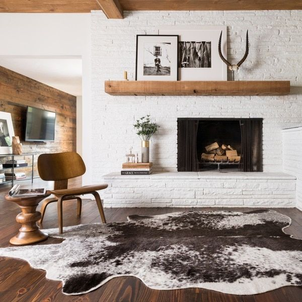 Infuse your home with rustic style with this Rawhide novelty rug.This faux-fur rug features a design inspired by actual cowhide, butoffers the durability of acrylic-fiber construction. Anivory-and-cha
