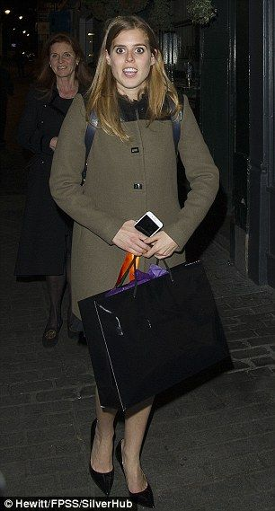 Beatrice, 28, looked chic in a collarless olive green coat adding a stylish leather rucksack
