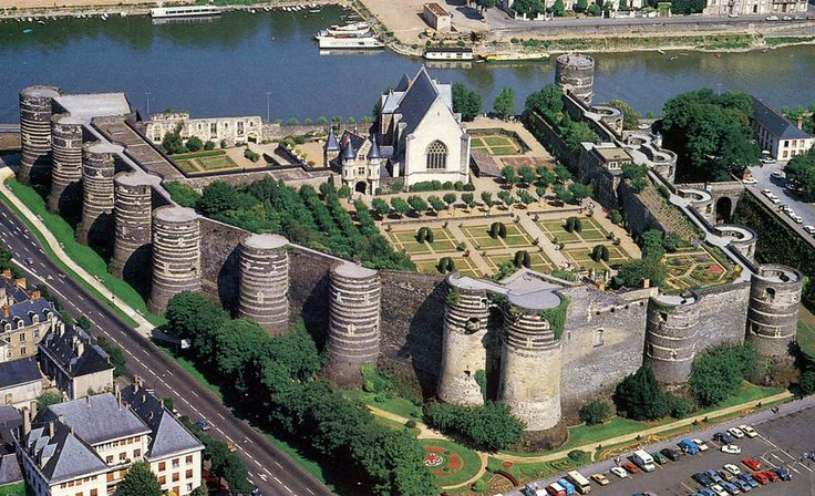 A postcard air view of the Château d'Angers, with its 17 massive towers.  The Maine River is in the background.  St. Maurice Cathedral has a long staircase going down to the river.  Many photos, including mine, are taken from the river side.