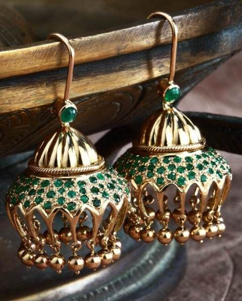 Moghul-inspired emerald jhumki - A rich, green emerald studded contemporary Indian jhumki handcrafted in 18k gold.
