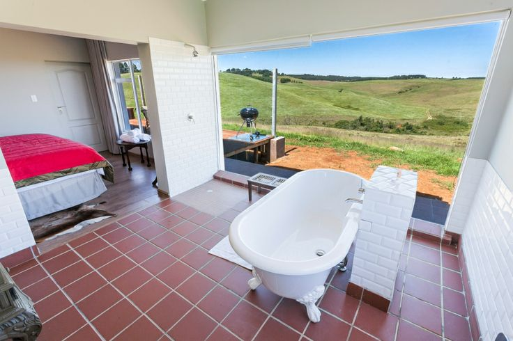 Self-catering lodges at the Windmills Resort offer bathrooms with a view Midlands Meander, KZN, South Africa www.midlandsmeander.co.za