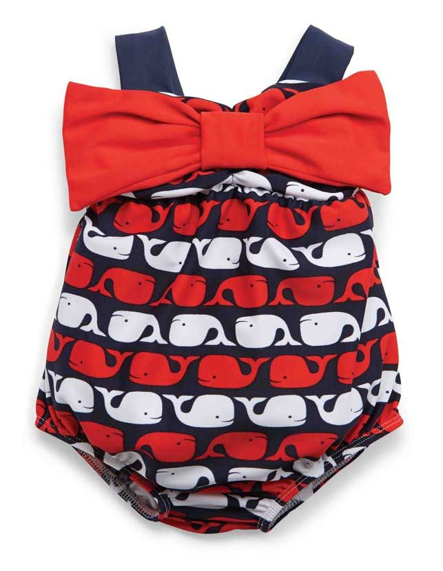 A retro-cut one piece girl's swimsuit for newborn, infant and toddler girls is a sweet take on a sea-faring girl's swimsuit. A red, white and blue swimsuit for girls has a big red bow and navy shoulder straps.