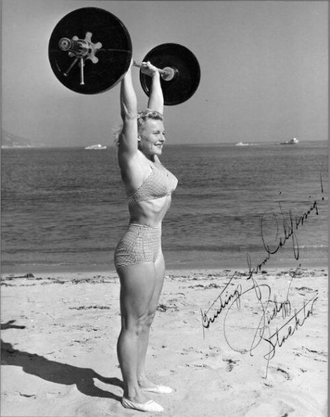 """Abbye """"Pudgy"""" Stockton was known as The """"First Lady of Iron."""" In the 1940s, she organized the first women's weight lifting contest and operated the first all-women's gym in the United States. She lifted, performed acrobatics on Muscle Beach and wrote extensively encouraging women to include weight training as part of a fitness regime."""