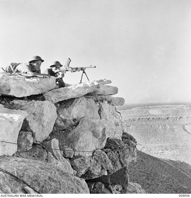 1941-09. TOBRUK. BREN GUN FIRE COVERS PATROLS WHICH ARE CONTINUOUSLY ATTACKING ENEMY OUTPOSTS IN THE ROCKY COUNTRY ABOUT TOBRUK.