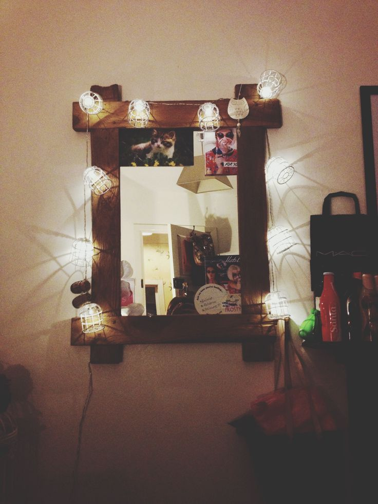 My bedroom decor essential, Big mirror with birdcage fairy lights. Perfect for doing your make up and hair in front of plus I added cute things that I have collected and stuck in the corners. I love the shadows that the birdcages cast on the walls too.