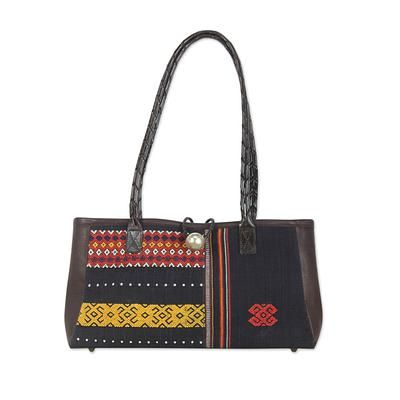 Leather accent cotton shoulder bag, 'Naga Tribal Black' - Woven by hand, beautiful textiles attest to the skill of Naga women, a tribal people from northeastern India and parts of Burma. The weavings are incorporated in this lovely handbag from Chirada. Brown leather forms the straps and adorns each side, while a button safeguards the zip top closure. Inside, the shoulder bag is lined in brown faux suede fabric and features three inner pockets, one with a zipper.