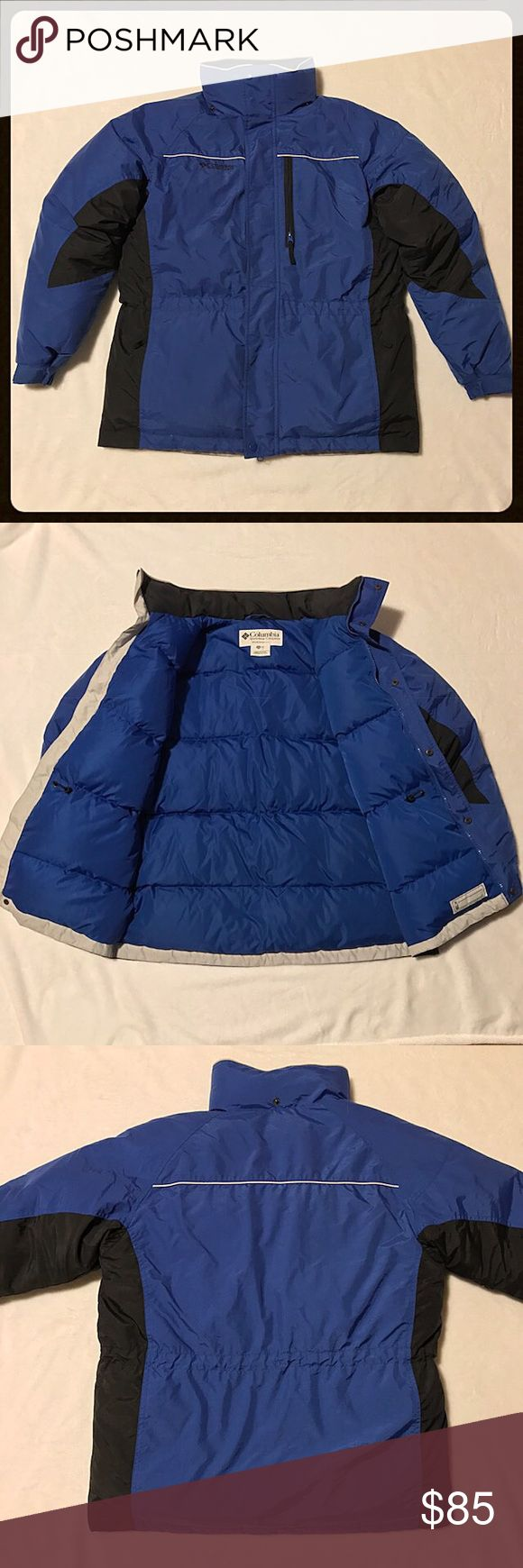 """Boy's Columbia Sportswear Company Insulated Jacket Royal blue & black insulated jacket, boy's size 18/20. 💯Nylon w/ Down & feather insulation. Zipper & snap closure. 2 zippered pockets w/ a 3rd on the left lapel. Interior drawstring at the waist. Measures 24"""" armpit to armpit, shoulder to hem 29"""". Arm length 23"""". Elastic w/ velcro sleeves. Small amount of staining on the inside collar (see pics). A little paint has chipped off the zipper & one inside snap has a little rust but does not…"""