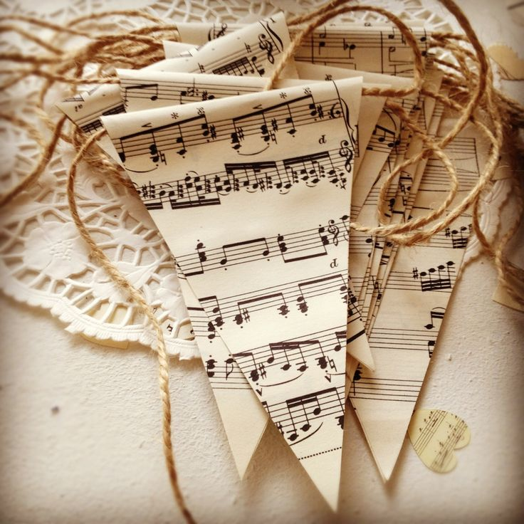 Vintage sheet music bunting w/burlap string -  Note how they folded the sheet music over the burlap.