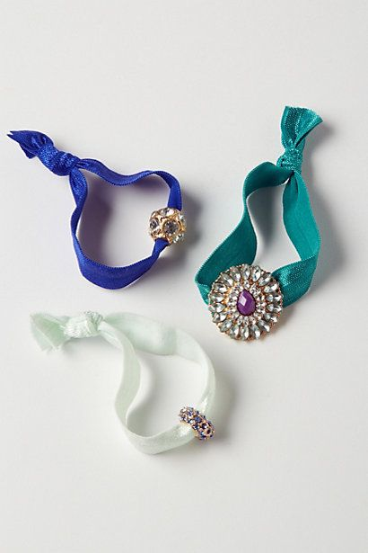Charmed Hair Ties #anthropologie.  I always wear the plain ribbon hair ties these days, but these ones with charms are so chic.
