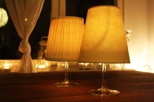 candles in wine glasses