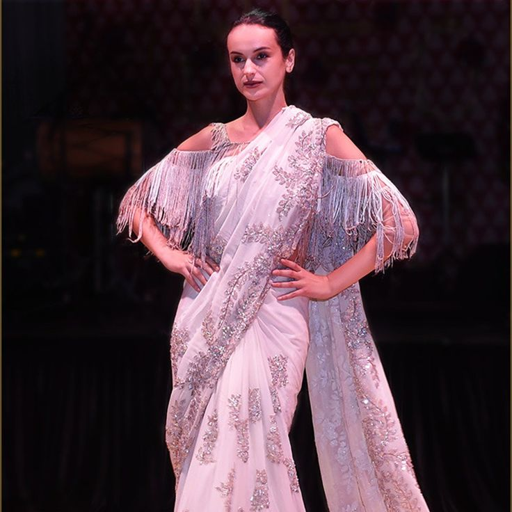 #ManishMalhotraLabel redefining the trend with this embroidered saree and cold shouldered fringed blouse.