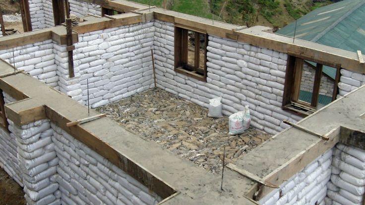 earthbag homes | Bond beam on earthbag school in Nepal.