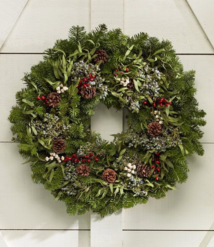 "Woodland Christmas - Eucalyptus sprigs add a willowy accent to noble fir and blue-berried juniper greens. Natural pinecones and faux red and tallow berries add pops of color and texture. Includes an over-the-door hanger. Approx. 24"" diam. Made in the Pacific Northwest.  Free shipping with L.L.Bean"