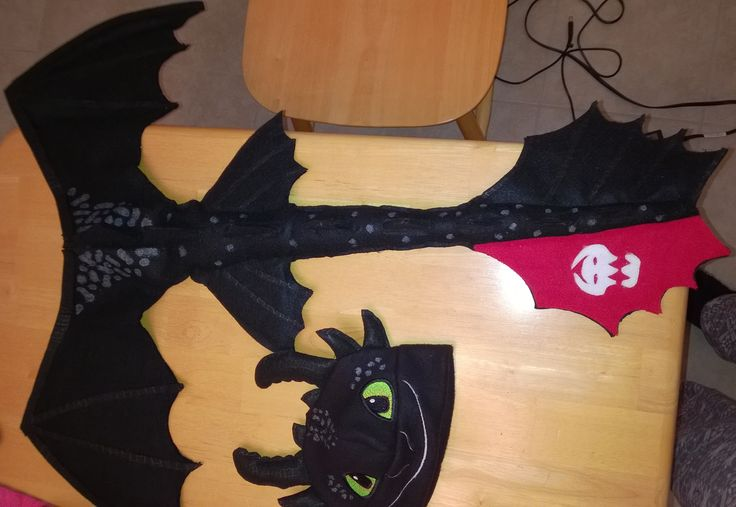 How to train your dragon toothless costume.  Hat made with embroidery file from Bella Bleu.  Tail made out of fell and hot glue.