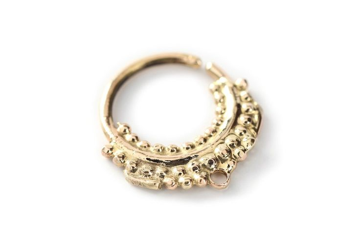 Septum - Gold nose ring 14k yellow gold - Septum jewelry - septum ring - Nose jewelry - tragus jewelry - nose hoop - cartilage. All Studio Lil's Jewellery is completely made by hand in our workshop in Forest Row, UK. Designs can also be used as a Nose ring/ Septum/ helix/ orbital/ snug piercing or in a tragus piercing. The ring is made to order. If there is any need of a specific size/ inner diameter please contact us, and we will be happy to help you with it. Also available in 925…