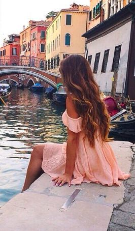 Beautiful photo... I Love all the colors of the buildings and the water... and that long wavy hair...