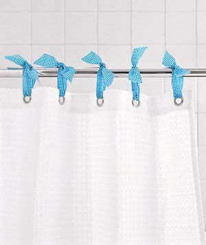 Great idea!...I've been doing this for years :)) ...For an easy and inexpensive way to hold up your shower curtain and give your bathroom a jolt of color, lace a ribbon through each hole and tie it in a knot, as shown. Snip off the ends at an angle.