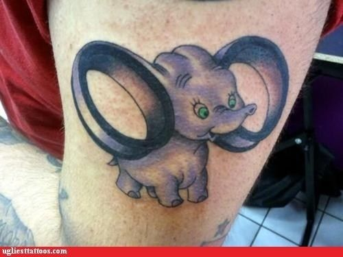 This person's showing off their alternative style with a cool punk rock Dumbo.   31 Highly Questionable Disney InspiredTattoos