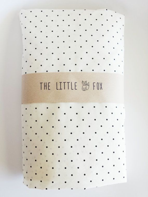This listing is for an Ivory / black spot fitted cot sheet.  It measures a generous 1400 x 700 x 190.  The sheet is made with elastic around