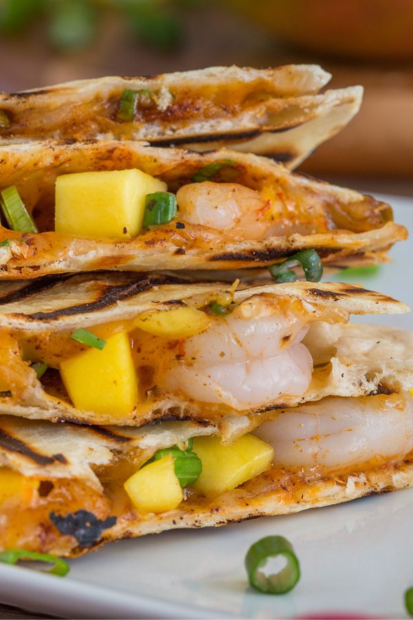 This shrimp quesadillas recipe features perfectly ripe mango, flavorful seasonings and Mexican cheeses. Just grill for less than 20 minutes and you have a quick and easy lent or summertime recipe.