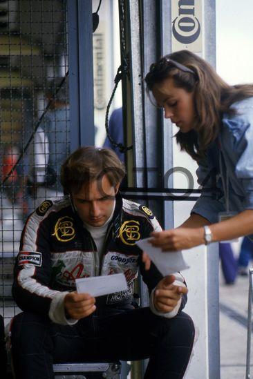 Elio de Angelis (ITA) Lotus with his girlfriend