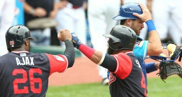 Cleveland Indians 'Slamtana' Carlos Santana celebrates with 'Ajax' Austin Jackson after Santana hit a 3 run homer in the 2nd inning against the Kansas City Royals at Progressive Field, Cleveland, Ohio, on August 27, 2017. This put the Indians up 8-0. Santana's home run hit the left field foul pole. (Chuck Crow/The Plain Dealer). Indians won 12-0