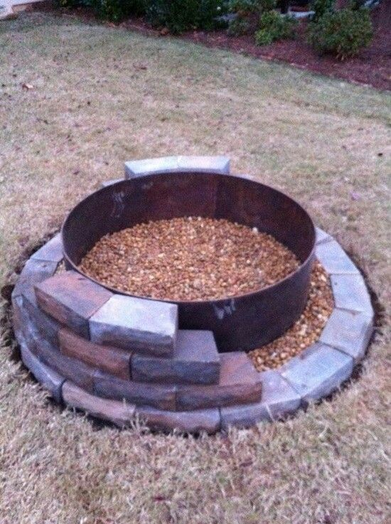 We can use the metal pit, dig a hole, place pit inside and just decorate with brick!!! Awesome!