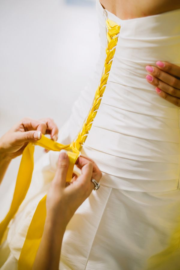 i like this idea to have the corset be the colors of the bridesmaids dresses...if my dress has this feature.
