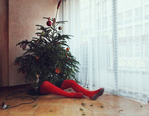 Hilarious display with a mannequin and small Christmas tree - great Christmas window display to show off your sense of humour...