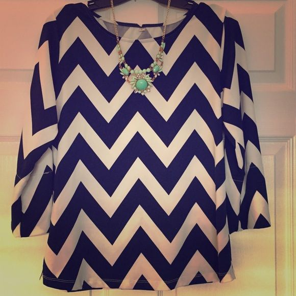 Navy Blue and Cream Chevron Top Comfortable yet Fabulous Navy Blue and Cream Chevron Top - It's stretchy so you can move all day long and not feel cramped! Size Large but fits like a Medium Tops Blouses