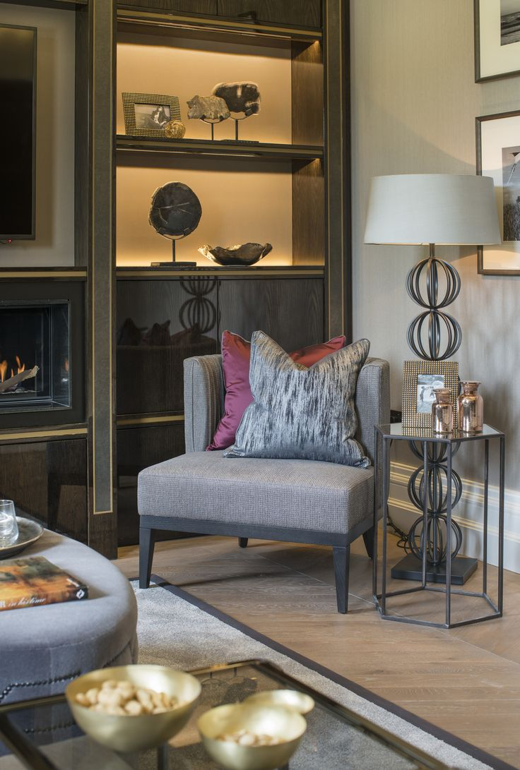 We combined this elegant Robert Langford side table with a timeless Rollo floor lamp by @HeathfieldAndCo in antique bronze to create the perfect focal point in this stunning drawing room interior design.