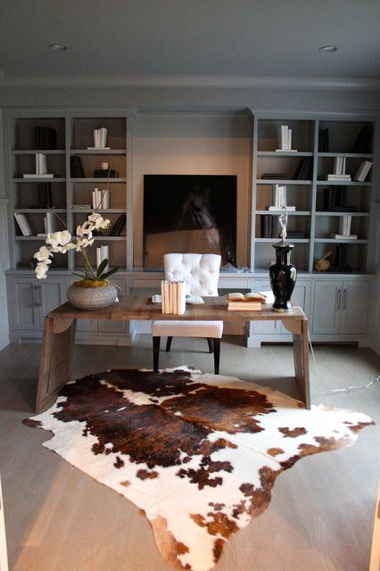 Love the desk, warm honey tone with the white. But not the shelf colours. Love the placment of cow hide rug. Will keep searching for placement of ours.