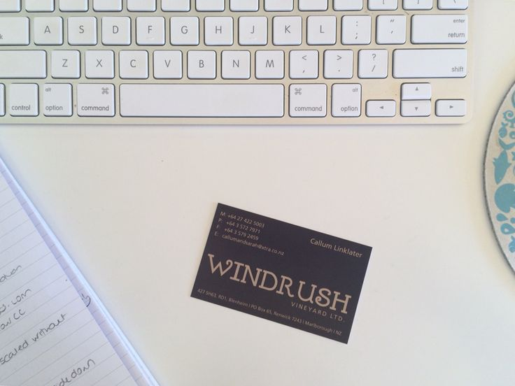 Business card. Sand colour can be hard to read in fine weight lines