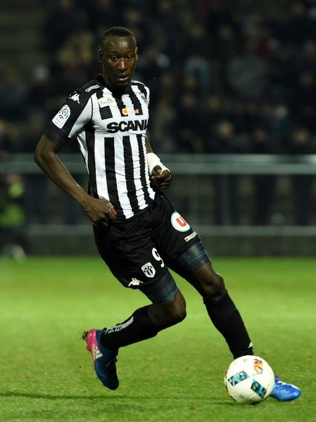 Angers' Senegalese forward Famara Diedhiou controls the ball during the French L1 football match between Angers (SCO) and Rennes, at the Jean Bouin Stadium, in Angers, northwestern France, on February 8, 2017.  / AFP / GUILLAUME SOUVANT