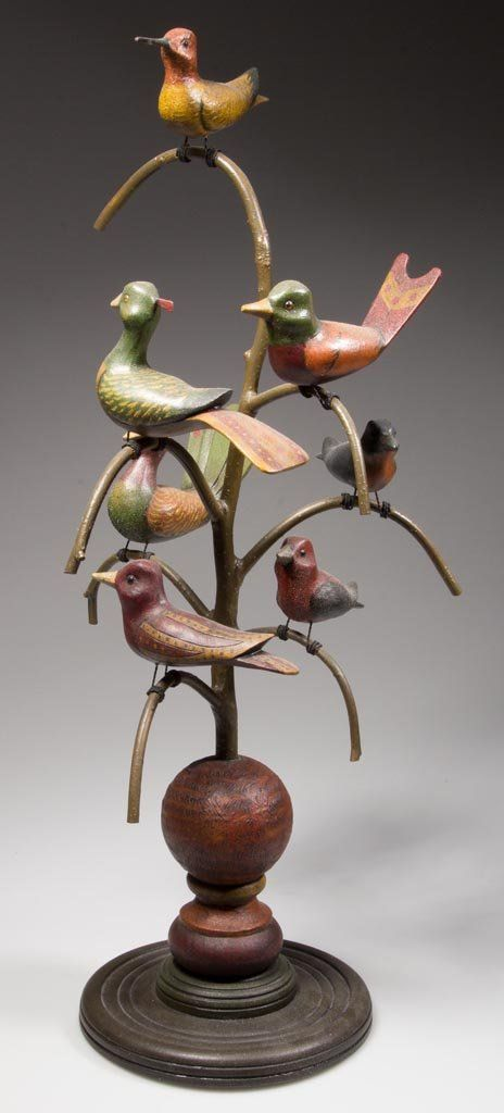 JOHN HOLLOWAY (NEW JERSEY) CARVED AND PAINTED FOLK ART BIRD TREE, a fine example depicting seven birds in a Pennsylvania German-style, rich ...