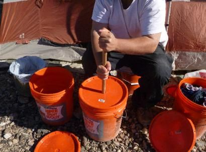 hand washing garments in a 5 gallon bucket - only takes a few minutes