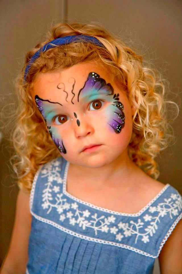 Blue butterfly face painting