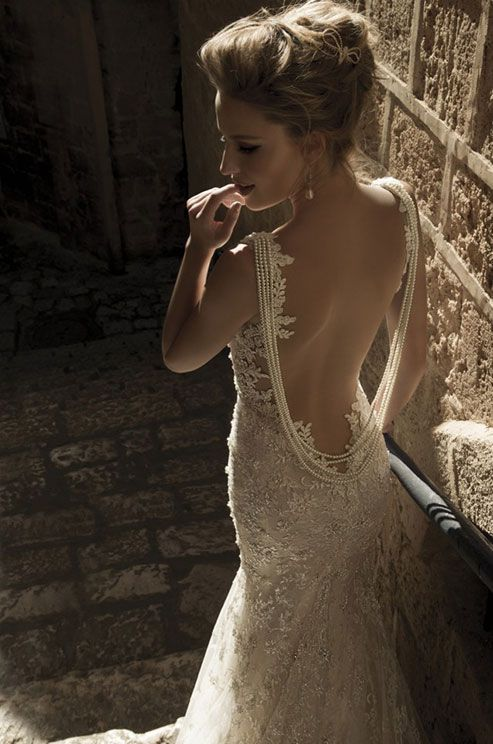 Tight lace mermaid dress with a sheer back. Pearl strands falling along the back. Galia Lahav, Spring 2015