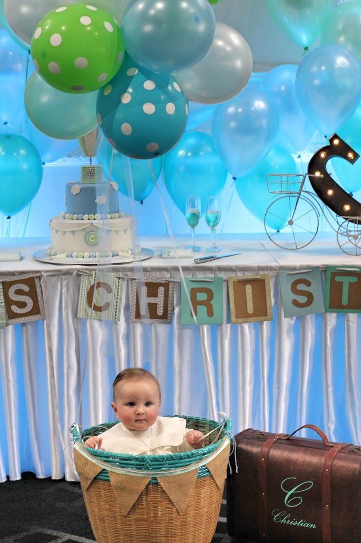 A hot air balloon is gorgeous idea to capture some amazing photos on your babies Christening/Baptism day