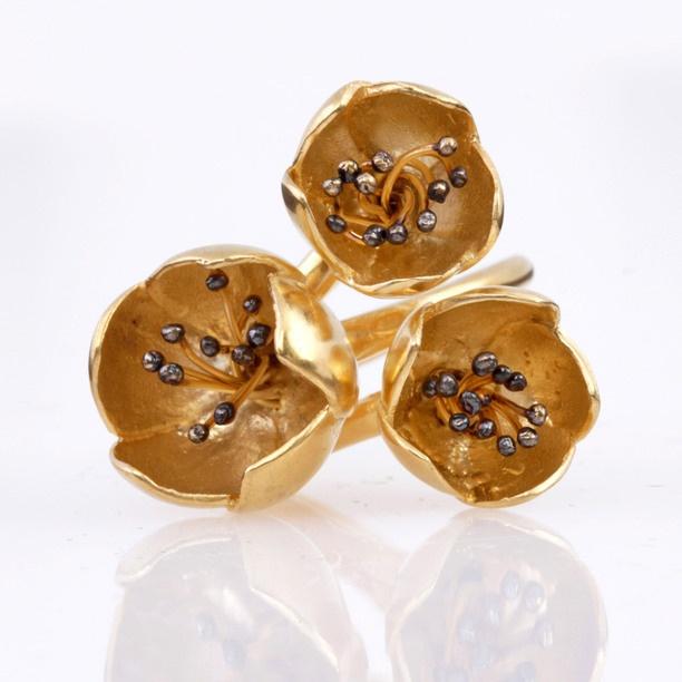 Ring with flower motif.