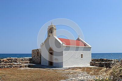 White chapel on the shore of the Aegean sea in Hersonissos. Crete, Greece
